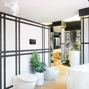 This is an example of an expansive asian loft-style bedroom in Madrid with black walls.