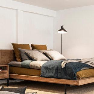 Diseño de dormitorio contemporáneo con paredes blancas, moqueta y suelo gris
