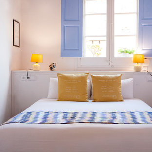 Bedroom - mid-sized mediterranean master ceramic tile bedroom idea in Barcelona with white walls