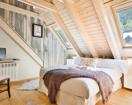 Example Of A Mid Sized Cottage Chic Master Medium Tone Wood Floor Bedroom  Design In