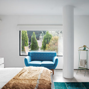 Inspiration for a large contemporary master limestone floor bedroom remodel in Madrid with white walls