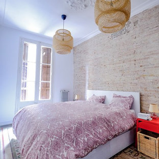 This is an example of a mid-sized scandinavian master bedroom in Barcelona with brown walls, terra-cotta floors and multi-coloured floor.