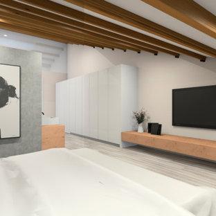Ejemplo de dormitorio tipo loft, nórdico, extra grande, con paredes beige, suelo de madera en tonos medios, chimeneas suspendidas y suelo gris