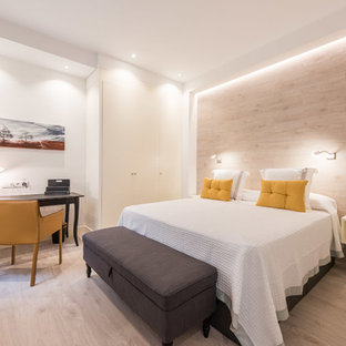Medium sized traditional master bedroom in Madrid with white walls, light hardwood flooring and no fireplace.
