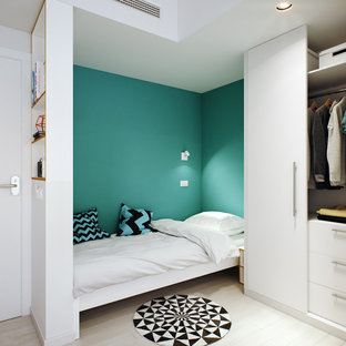 Photo of a small scandinavian loft-style bedroom in Madrid with painted wood floors.