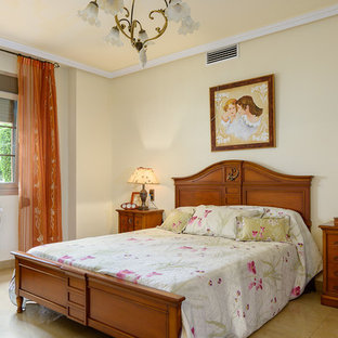 Bedroom - mid-sized traditional master travertine floor bedroom idea in Bilbao with beige walls and no fireplace
