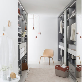 Design ideas for a large scandinavian gender-neutral dressing room in Lyon with open cabinets and grey cabinets.