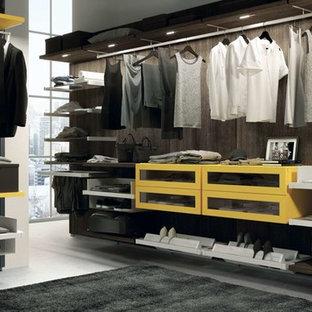 На фото: парадная гардеробная среднего размера в стиле модернизм с открытыми фасадами и желтыми фасадами для женщин с