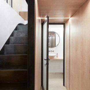 Foto de armario y vestidor madera, contemporáneo, con suelo de cemento y suelo beige