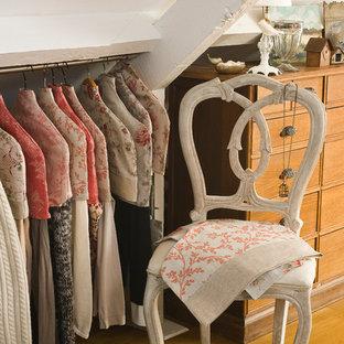 Cottage chic closet photo in Paris