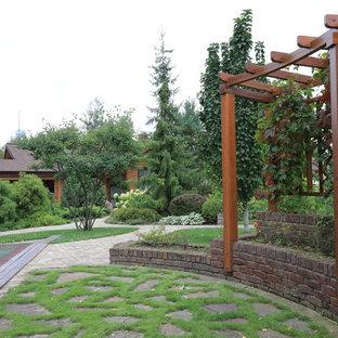 Foto di un patio o portico country con una pergola