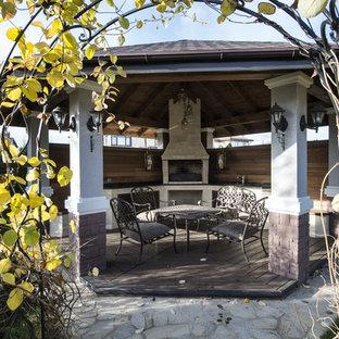 Свежая идея для дизайна: дворик на внутреннем дворе в современном стиле с летней кухней и беседкой - отличное фото интерьера