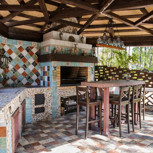 Romantic patio in Novosibirsk with an outdoor kitchen.