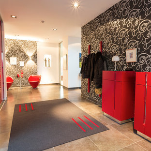 Large contemporary foyer in Dusseldorf with white walls, ceramic flooring and brown floors.