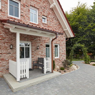 Mid-sized cottage gray floor entryway photo in Bremen with red walls and a white front door