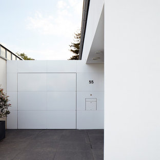 Single front door - contemporary granite floor single front door idea in Cologne with white walls and a white front door