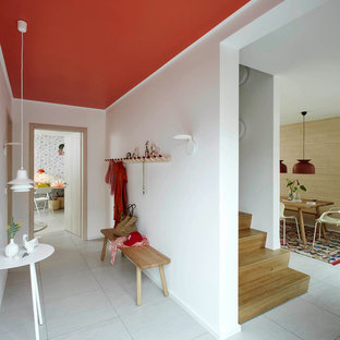 Mid-sized 1950s concrete floor mudroom photo in Hamburg with white walls