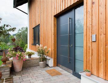 Holzfassade trifft Aluminium