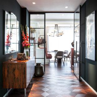 Inspiration för en mycket stor industriell foajé, med gröna väggar, mellanmörkt trägolv, en enkeldörr, en vit dörr och brunt golv