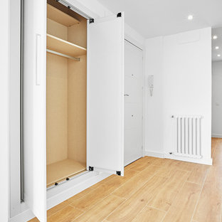 Entryway - small scandinavian terra-cotta floor and yellow floor entryway idea in Other with white walls and a white front door