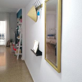 Imagen de hall costero, pequeño, con paredes azules, suelo de terrazo, puerta simple, puerta azul y suelo beige