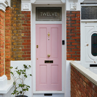 This is an example of a traditional front door in London with a single front door.