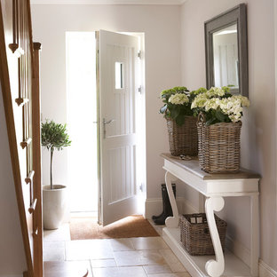 Mid-sized elegant limestone floor entryway photo in Buckinghamshire with gray walls