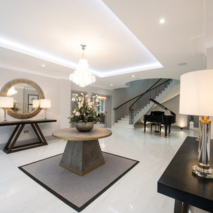 Design ideas for a large contemporary entrance in London with porcelain flooring and beige floors.