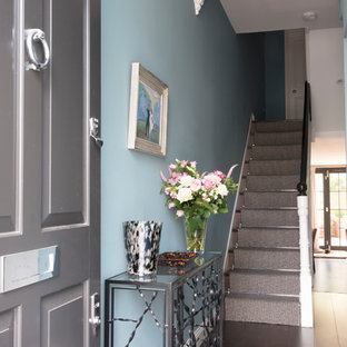 Classic foyer in London with blue walls, dark hardwood flooring, brown floors, a single front door and a grey front door.