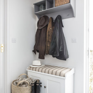 Example of a small coastal mudroom design in Cornwall with white walls