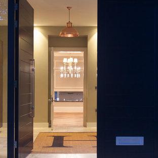 На фото: класса люкс большие вестибюли в современном стиле с бежевыми стенами, полом из известняка, двустворчатой входной дверью и черной входной дверью