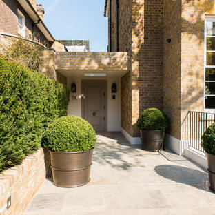 This is an example of a large contemporary front door in London with a single front door.