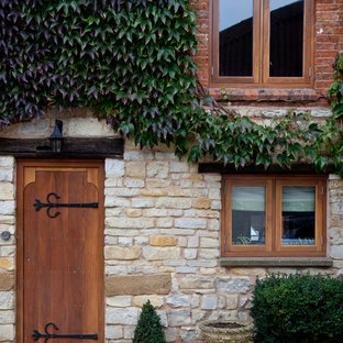 Inspiration for a farmhouse entryway remodel in West Midlands with a medium wood front door