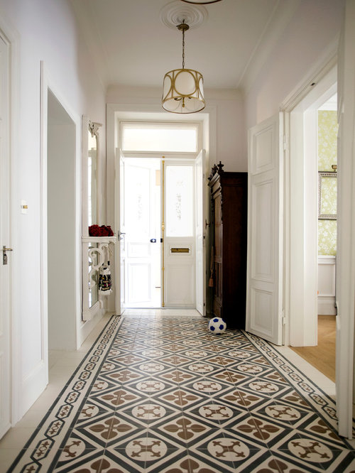 Traditional Entry Hall Idea In London With White Walls And A White Front  Door