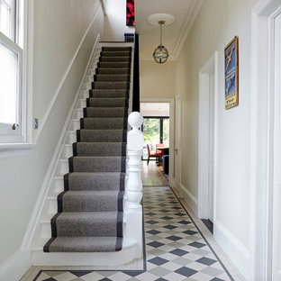 Small contemporary hallway in London with white walls and ceramic flooring.