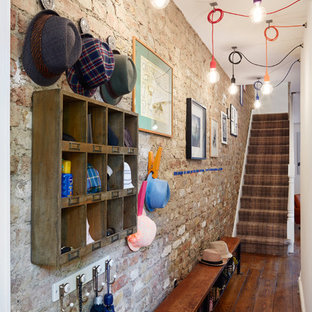 Design ideas for a small bohemian boot room in London with dark hardwood flooring.