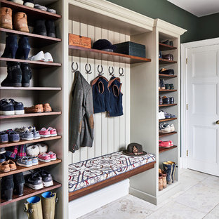 Classic boot room in Cheshire with green walls and beige floors.