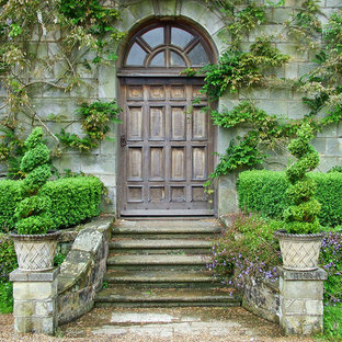Inspiration for an expansive traditional front door in Cornwall with a single front door and a dark wood front door.