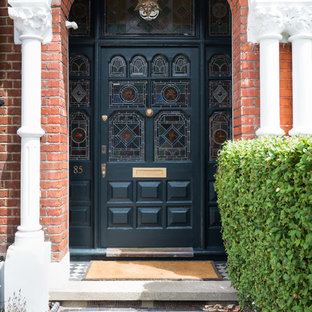 This is an example of a large classic front door in London with a single front door and a black front door.
