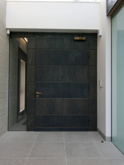 Inspiration For A Contemporary Front Door Remodel In Edinburgh With White  Walls And A Dark Wood