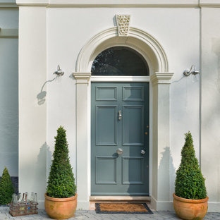 Photo of a traditional front door in Devon with a single front door and a blue front door.