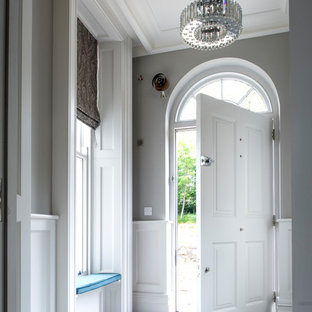 Inspiration for a large classic foyer in London with grey walls, a single front door, a white front door and multi-coloured floors.
