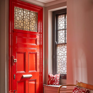 Inspiration for a timeless medium tone wood floor and brown floor entryway remodel in London with gray walls and a red front door