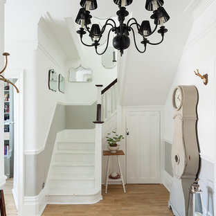 Inspiration for a medium sized traditional entrance in London with light hardwood flooring, beige floors and white walls.