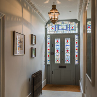 Design ideas for a medium sized traditional hallway in London with grey walls, ceramic flooring, a single front door and a grey front door.