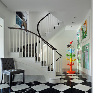 This is an example of a contemporary entrance in London with white walls and multi-coloured floors.