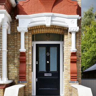 Ex&le of an ornate entryway design in London with a black front door & Front Door Canopy | Houzz