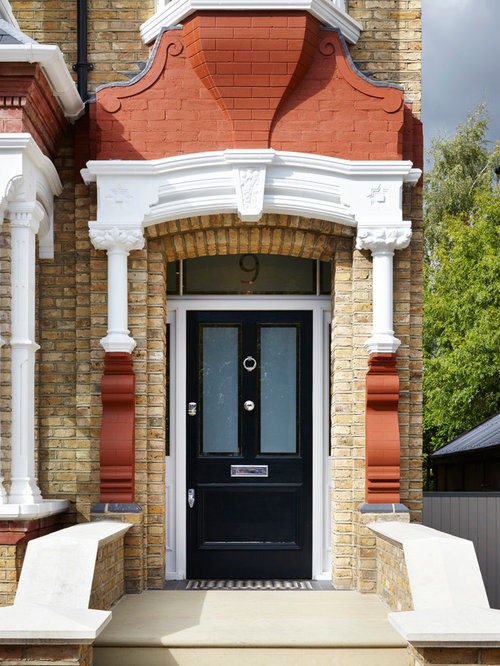 High Quality Example Of An Ornate Front Door Design In London With A Single Front Door  And A