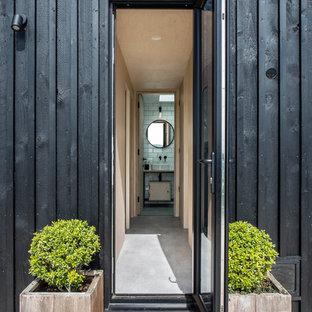 Scandinavian front door in Oxfordshire with a single front door and a glass front door.