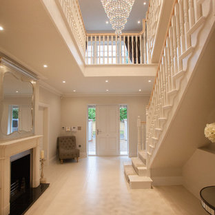 Classic foyer in Surrey with a single front door and a white front door.